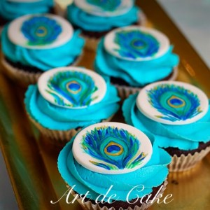 hand painted peacock cupcakes